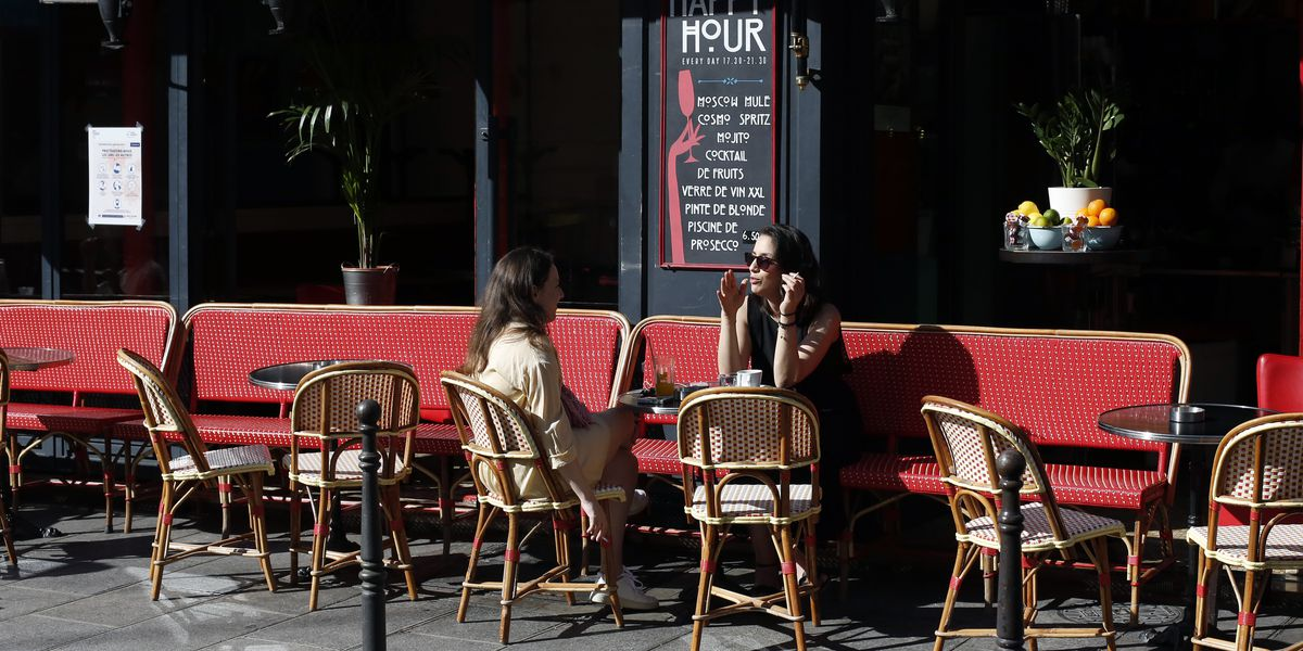 Parisians return to cafes; Latin America sees virus surge