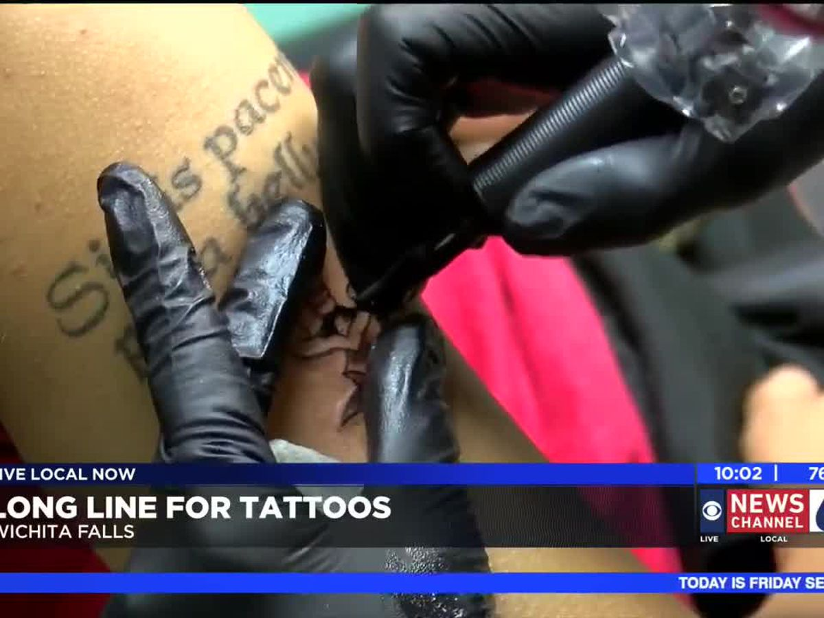 Long lines for Friday the 13th tattoos and piercings