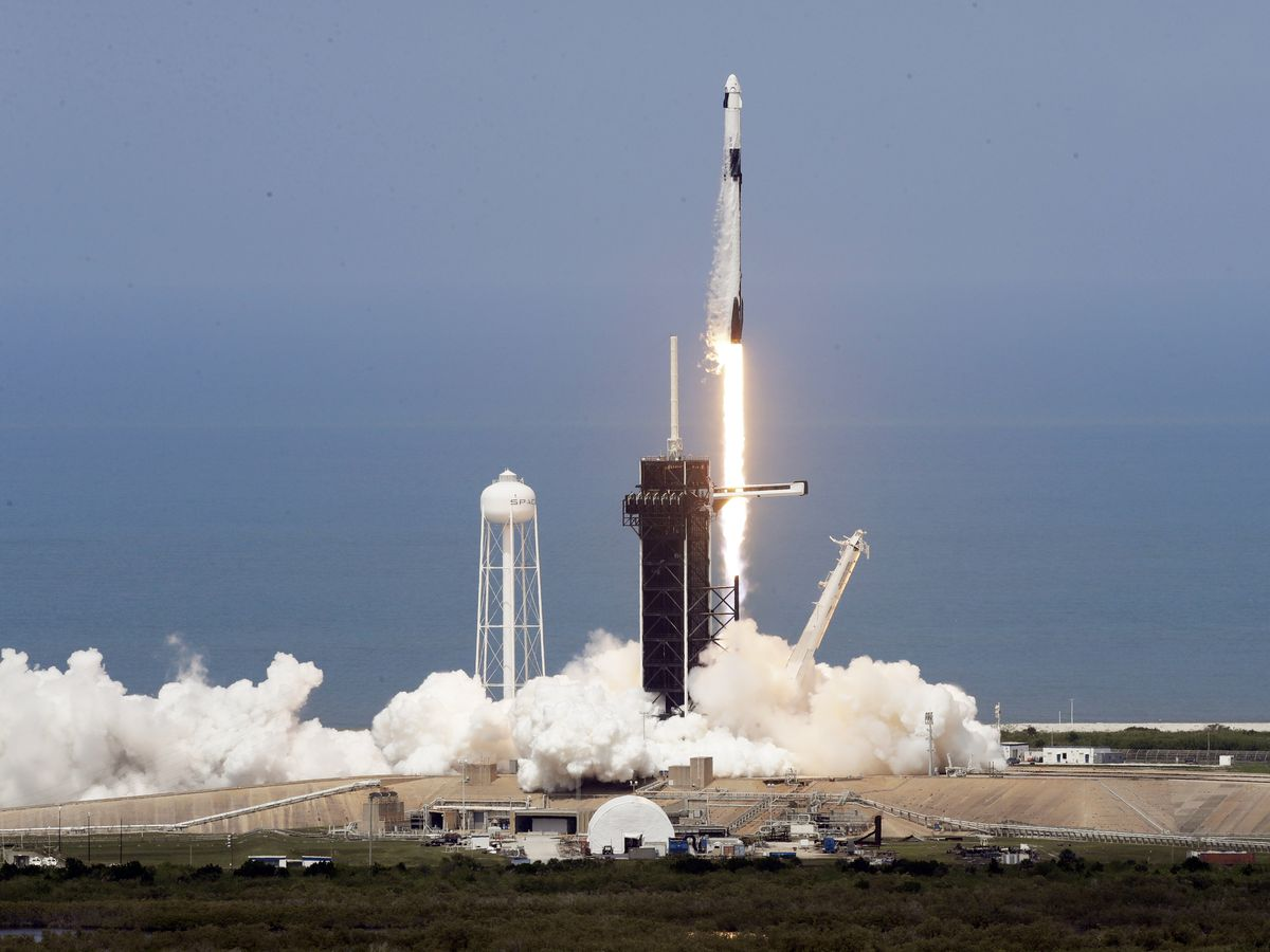 SpaceX rocket ship blasts off into orbit with 2 Americans