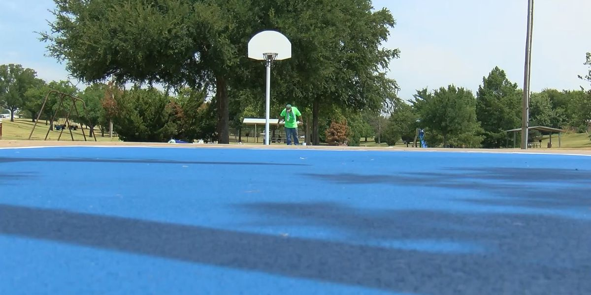 Local group paints community basketball court