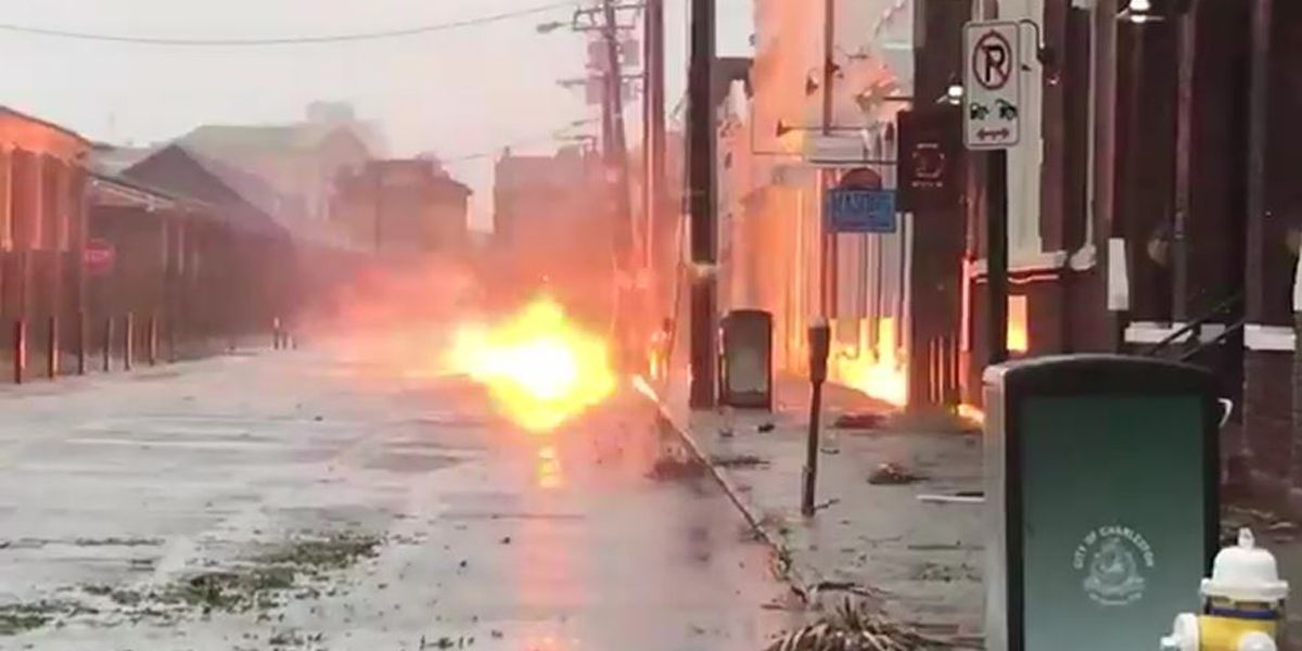 Fallen live power line sparks on flooded Charleston street during Dorian