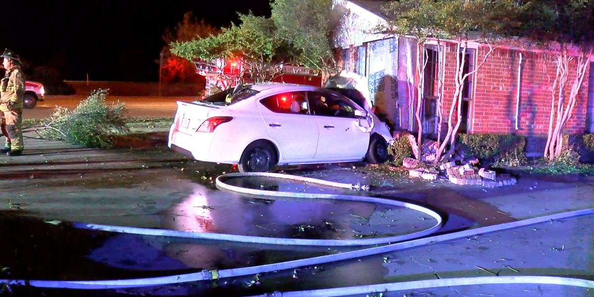 Neighbors pull woman from burning car