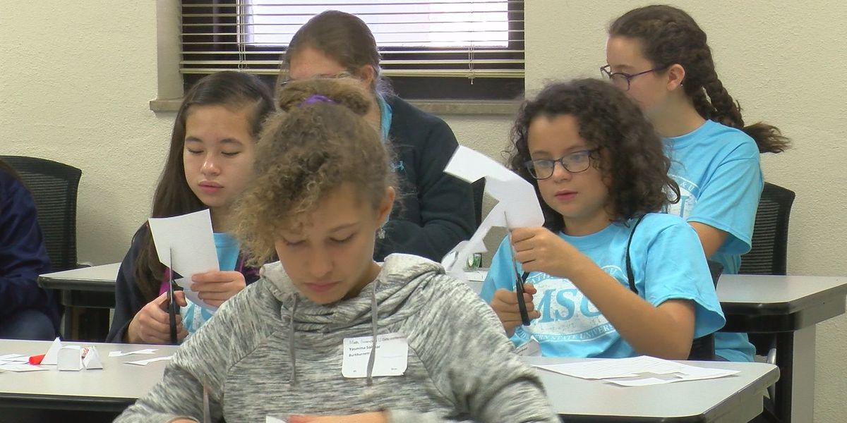 Female junior high students attend math, science and engineering workshops