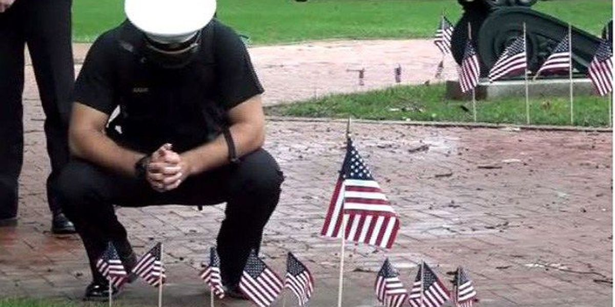 Midshipmen place flags at Naval Academy to mark 9/11