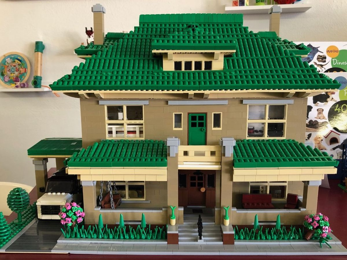 Toy shop owner builds Lego version of his own house