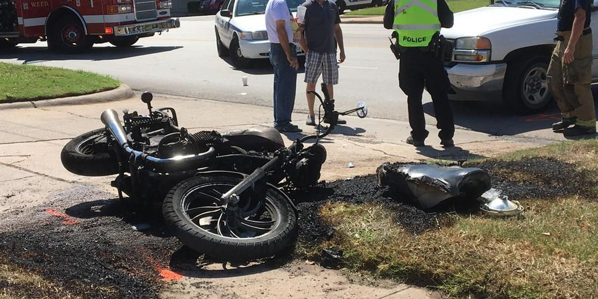 Motorcycle bursts into flames after crash