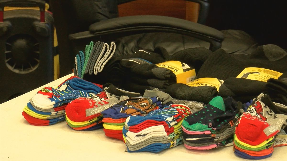 Community helps WF Faith Mission provide socks to those in need