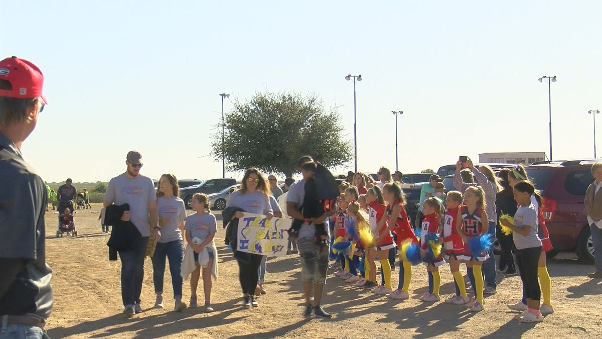 Participants raise Down syndrome awareness at 2nd annual Buddy Walk