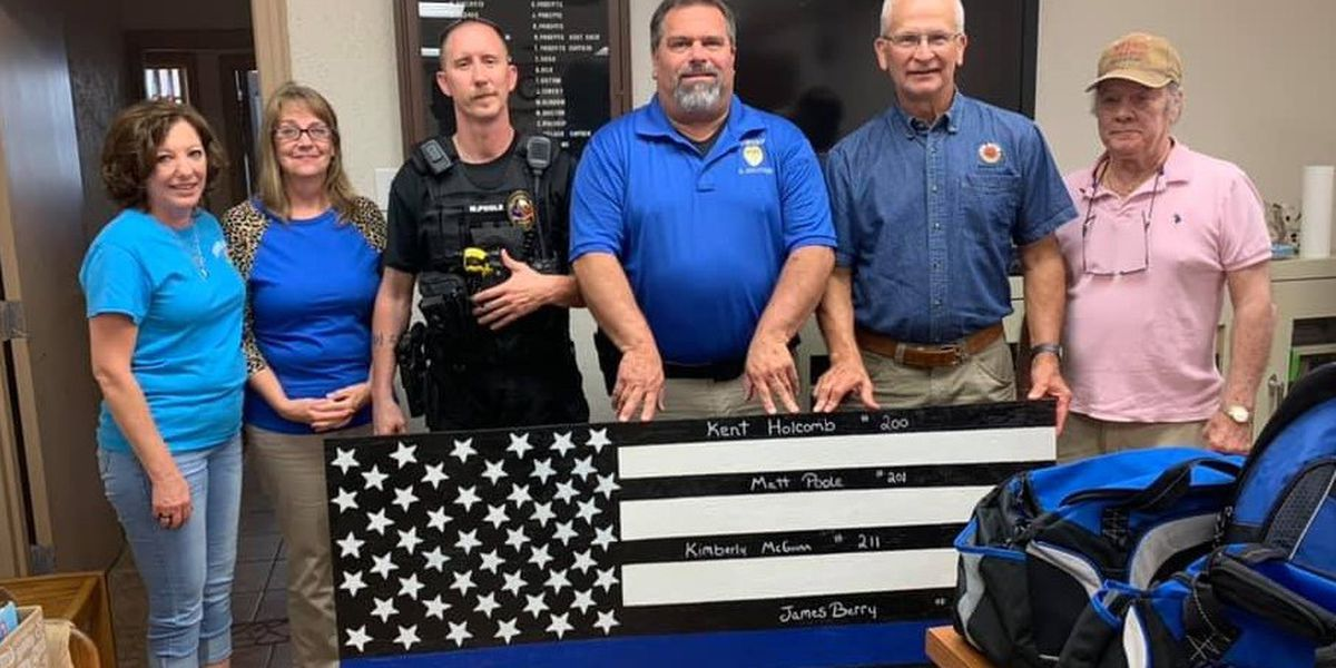 Nocona PD receives blessing bags, wooden flag