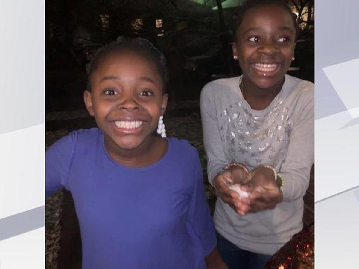 Two young girls from Congo see snow for the first time