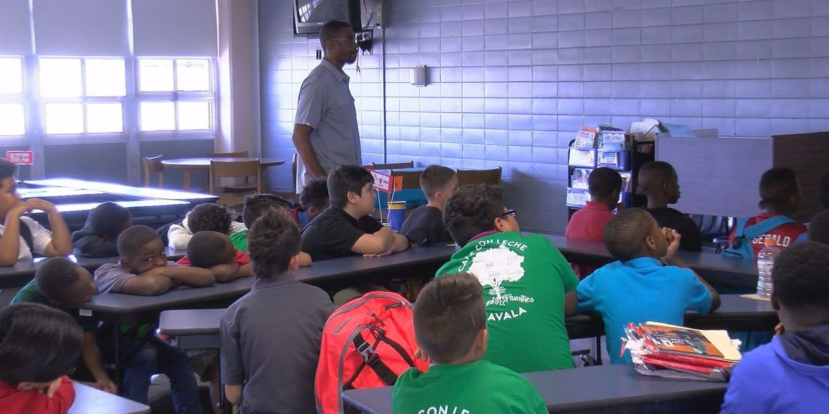 Men in Action group at Booker T. Washington molds boys into young men