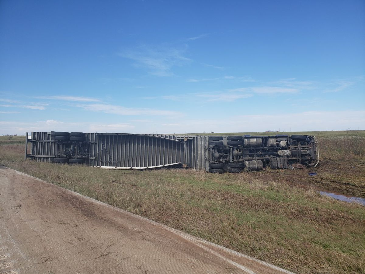 Semi rolls onto side near Electra