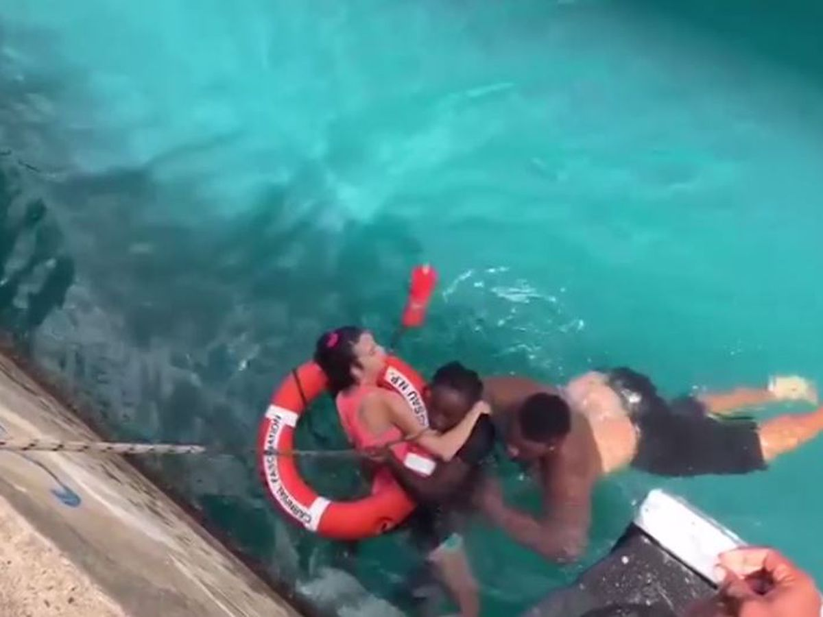 WATCH: Good Samaritans rush to rescue woman in wheelchair who fell off pier