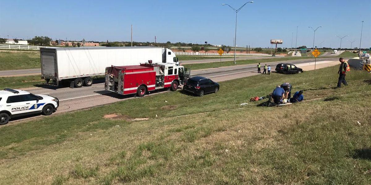 UPDATE: Vehicle rolls down embankment, hitting a semi on 287, 3 injured