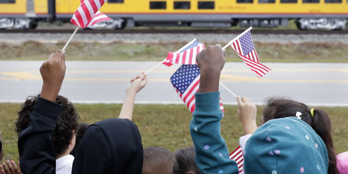 Flag-waving crowds in Texas watch Bush's funeral train